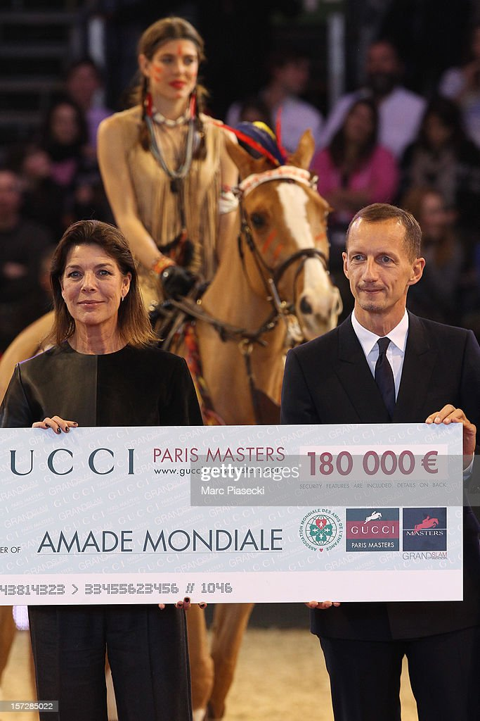 Princess Caroline of Hanover, Charlotte Casiraghi and Robert Triefus attend the 'Gucci Paris Masters 2012' at Paris Nord Villepinte on December 1, 2012 in Paris, France.