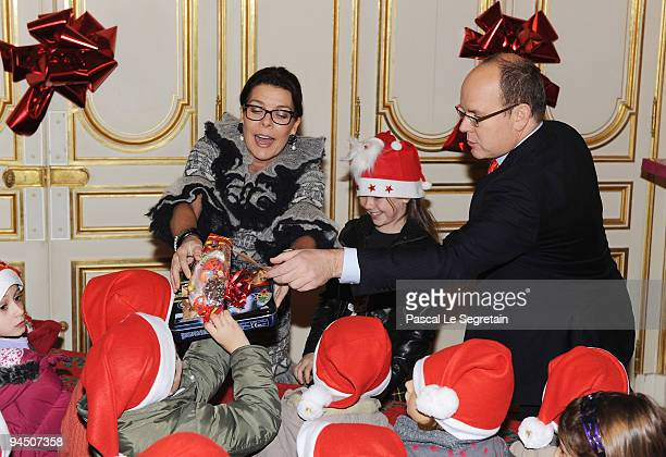Princess Caroline of Hanover her daughter Princess Alexandra of Hanover and Prince Albert II of Monaco distribute presents to Monegasque children...