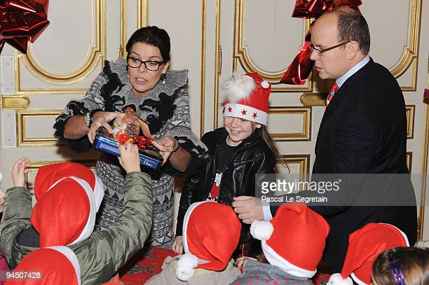 Princess Caroline of Hanover her daughter Princess Alexandra of Hanover and Prince Albert II of Monaco distribute presents to Monegasque children...