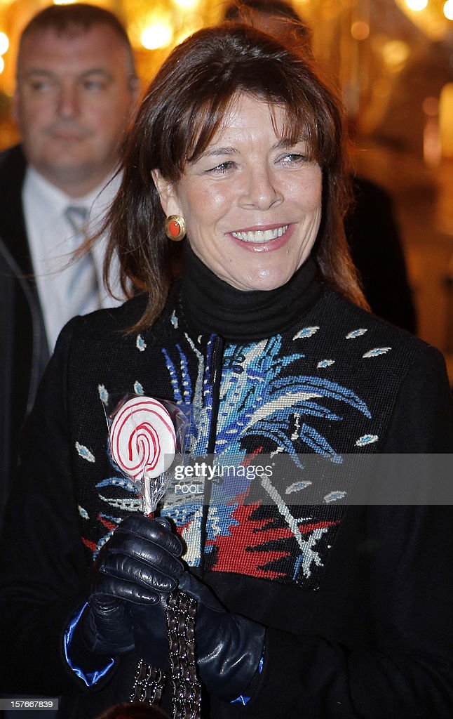 Princess Caroline of Hanover holds a lollipop during the opening of the Christmas village in Monaco, on December 5, 2012.