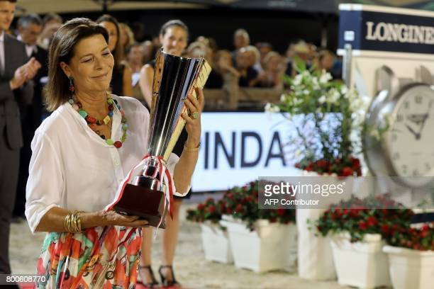 Princess Caroline of Hanover holds the trophy during the podium ceremony of the Jumping International of Monaco horse jumping competition as part of...