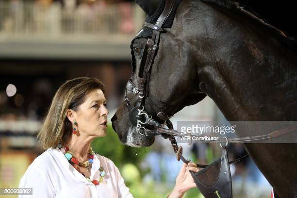 Princess Caroline of Hanover kisses the winning horse during the podium ceremony of the Jumping International of Monaco horse jumping competition as...