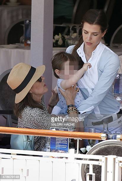 Princess Caroline of Hanover looks at Charlotte Casiraghi and her son Raphael during the 2015 edition of the Jumping International of Monaco horse...