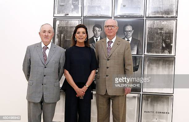Princess Caroline of Hanover poses with Gilbert and George during a visit of the 'Gilbert and George' exhibition held at the 'New National Museum' in...