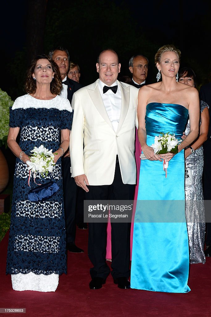 Princess Caroline of Hanover, <a gi-track='captionPersonalityLinkClicked' href=/galleries/search?phrase=Prince+Albert+II+of+Monaco&family=editorial&specificpeople=201707 ng-click='$event.stopPropagation()'>Prince Albert II of Monaco</a> and Princess <a gi-track='captionPersonalityLinkClicked' href=/galleries/search?phrase=Charlene+-+Princess+of+Monaco&family=editorial&specificpeople=726115 ng-click='$event.stopPropagation()'>Charlene</a> of Monaco attend the 65th Monaco Red Cross Ball Gala at Sporting Monte-Carlo on August 2, 2013 in Monte-Carlo, Monaco.