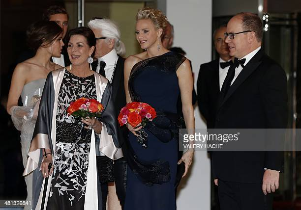 Princess Caroline of Hanover Princess Charlene of Monaco and Prince Albert II of Monaco arrive for the annual Rose Ball at the MonteCarlo Sporting...