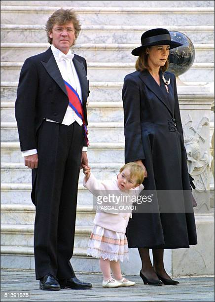 Princess Caroline of Monaco and her husband Prince Ernst August of Hanover stand with their daughter Alexandra 19 November 2001 during celebrations...