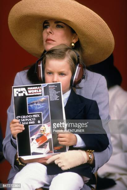 Princess Caroline of Monaco and son Andrea Casiraghi seating on her knees at Grand Prix car racing on May 7 1989 in Monaco