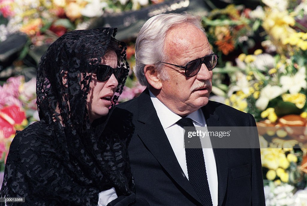 Princess Caroline of Monaco arrives 06 October 1990 with her father, Prince Rainier III at the Monaco cathedral to attend the funeral ceremony for her husband Stefano Casiraghi who was killed in an offshore powerboat racing accident off the coast of Monaco 03 October 1990 while defending his World Off-shore title.