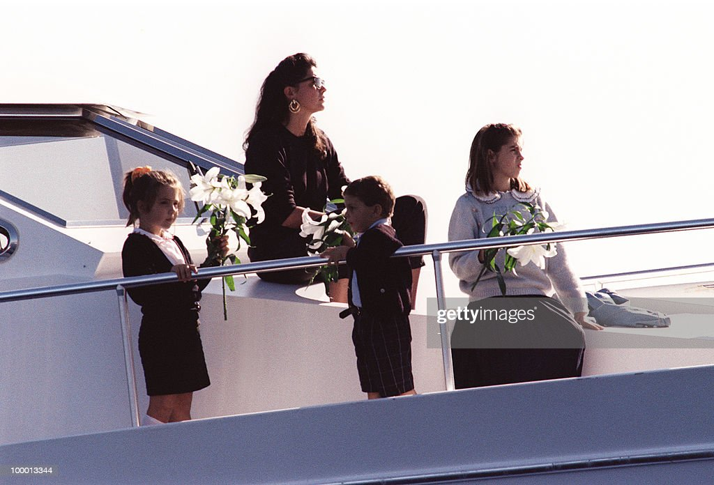 Princess Caroline of Monaco attends 06 October 1990 a ceremony on a boat at the site where Stefano Casiraghi was killed in an offshore powerboat racing accident off the coast of Monaco 03 October 1990 while defending his World Off-shore title. The children are unidentified.