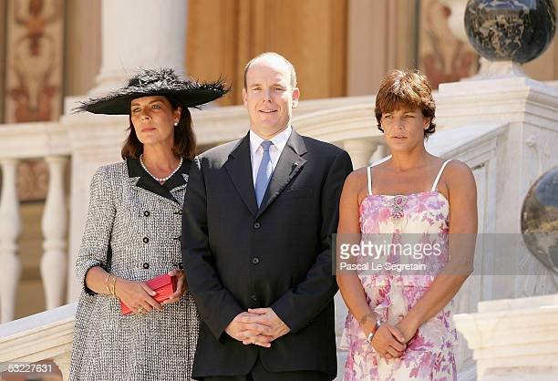 Princess Caroline of Monaco Prince Albert II of Monaco and Princess Stephanie of Monaco pose in the court yard of the Palace of Monaco for an...