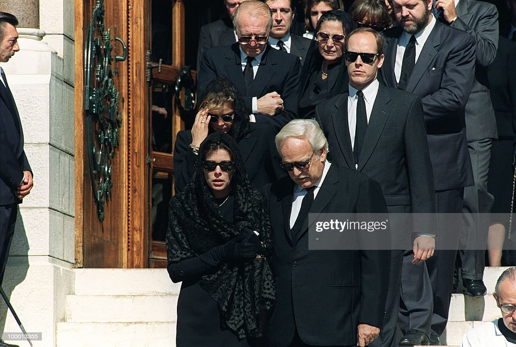 Princess Caroline of Monaco (1st row L), Prince Rainier III (2nd row R), Prince Albert (2nd row R), Princess Stephanie (2nd row L) and Stefano Casiraghi's parents (background) leave 06 October 1990 the Monaco cathedral after the funeral ceremony for Princess Caroline's husband Stefano Casiraghi who was killed in an offshore powerboat racing accident off the coast of Monaco 03 October 1990 while defending his World Off-shore title.