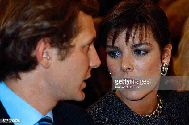 Princess Caroline of Monaco talks with her husband Stefano Casiraghi at the Dior 1985 SpringSummer haute couture fashion show in Paris