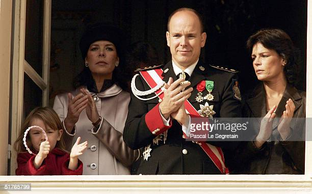 Princess Caroline with her daughter Princess Alexandra Prince Albert and Princess Stephanie stand at a balcony as part of the National Day...