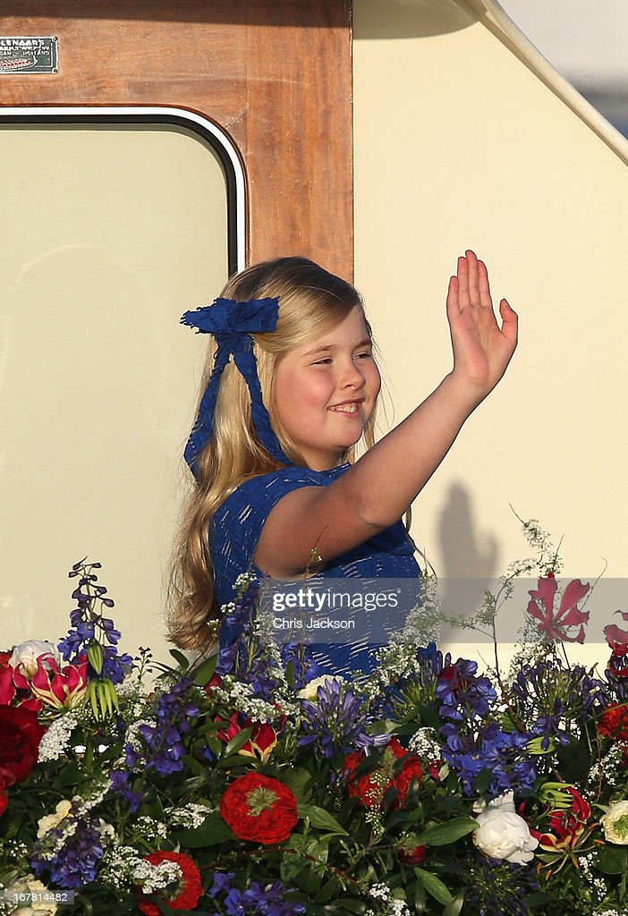 Princess Catharina-Amalia is seen aboard the King's boat for the water pageant to celebrate the inauguration of King Willem Alexander of the Netherlands after the abdication of his mother Queen Beatrix of the Netherlands on April 30, 2013 in Amsterdam, Netherlands.