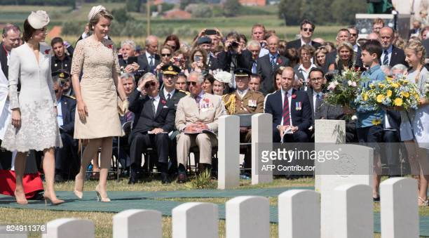 Princess Catherine Duchess of Cambridge and Queen Mathilde of Belgium walk at the Tyne Cot Commonwealth War Graves Cemetery in Zonnebeke on July 31...