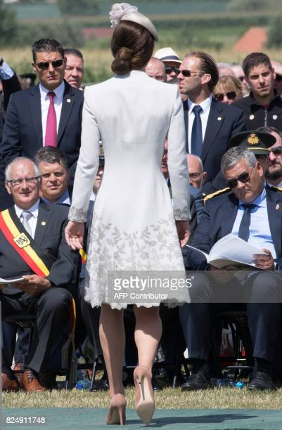 Princess Catherine Duchess of Cambridge walks as mayor of Zonnebeke Dirk Sioen and Belgian Minister of Defence and Public Service Steven Vandeput...
