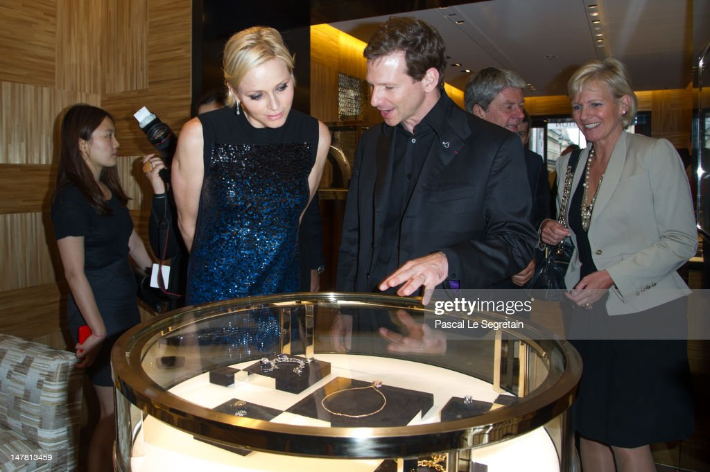 Princess Charlene and Louis Vuitton Jewelry Designer, Lorenz Baumer attend the Louis Vuitton new boutique opening as part of Paris Haute-Couture Fashion Week Fall / Winter 2012/13 at Place Vendome on July 3, 2012 in Paris, France.