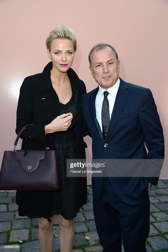 Princess Charlene of Monaco and Michael Burke attend the Louis Vuitton show as part of the Paris Fashion Week Womenswear Spring/Summer 2014 at Le Carre du Louvre on October 2, 2013 in Paris, France.