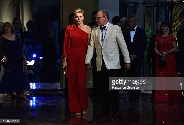 Princess Charlene of Monaco and Prince Albert II of Monaco arrive at the Monaco Red Cross Gala on July 25 2015 in MonteCarlo Monaco