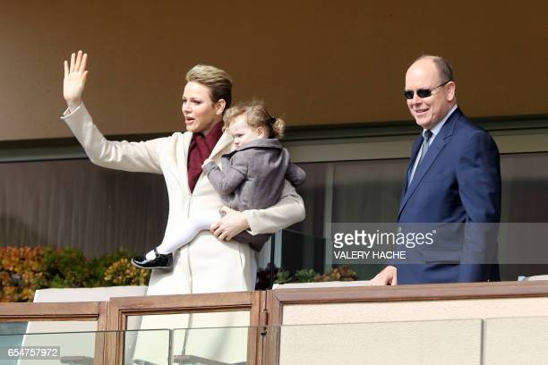 TOPSHOT Princess Charlene of Monaco and Prince Albert II of Monaco arrive with their daughter princess Gabriella de Monaco for the International...