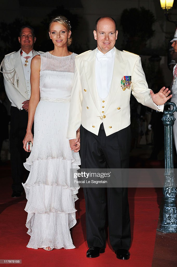 Princess Charlene of Monaco and Prince Albert II of Monaco attend a dinner at Opera terraces after their religious wedding ceremony on July 2, 2011 in Monaco. The Roman-Catholic ceremony followed the civil wedding which was held in the Throne Room of the Prince's Palace of Monaco on July 1. With her marriage to the head of state of the Principality of Monaco, Charlene Wittstock has become Princess consort of Monaco and gains the title, Princess Charlene of Monaco. Celebrations including concerts and firework displays are being held across several days, attended by a guest list of global celebrities and heads of state.