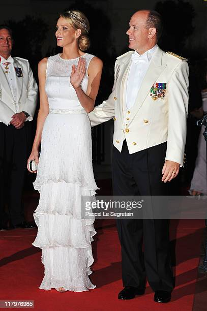 Princess Charlene of Monaco and Prince Albert II of Monaco attend a dinner at Opera terraces after their religious wedding ceremony on July 2 2011 in...