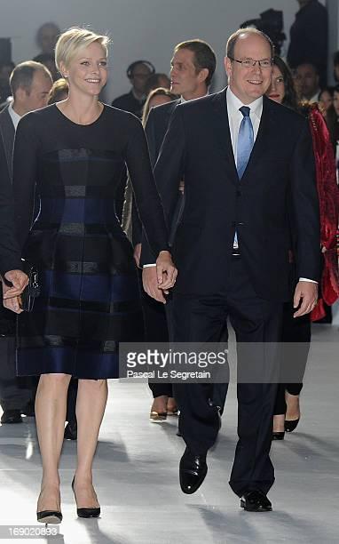 Princess Charlene of Monaco and Prince Albert II of Monaco attend the Dior Cruise Collection 2014 show on May 18 2013 in Monaco Monaco