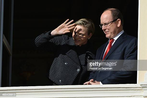 Princess Charlene of Monaco and Prince Albert II of Monaco attend the SainteDevote ceremony on January 26 2014 in Monaco Monaco