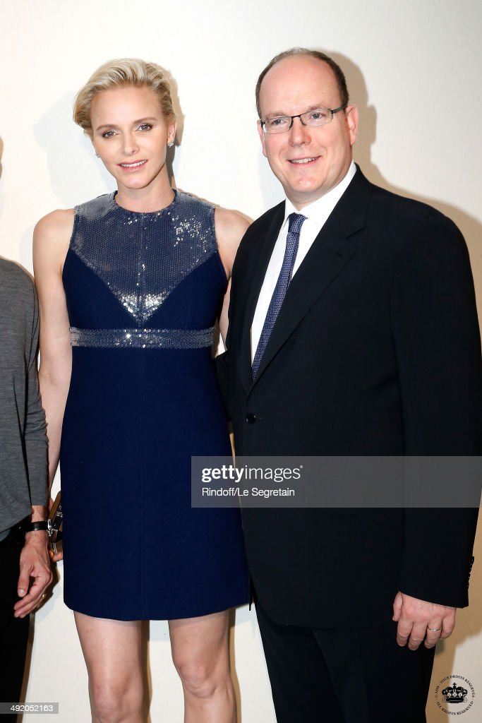 Princess Charlene of Monaco and Prince Albert II of Monaco attend the Louis Vuitton Cruise Line Show 2015 After Show Cocktail at Palais Princier on...