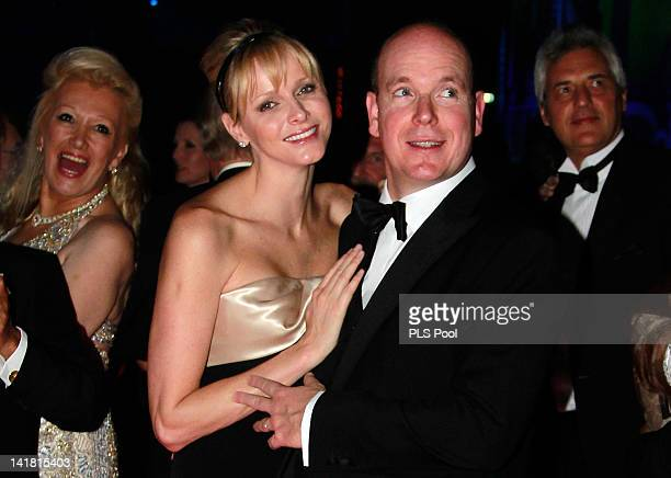 Princess Charlene of Monaco and Prince Albert II of Monaco dance during the 'Swinging London' Monaco Rose Ball 2012 at Sporting MonteCarlo on March...