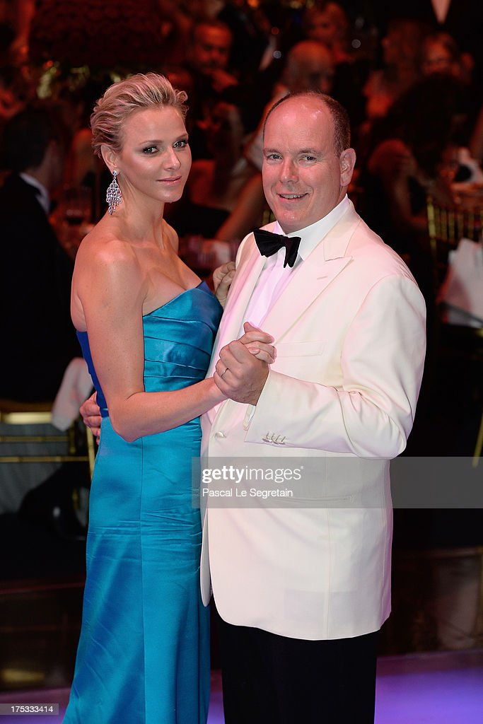 Princess <a gi-track='captionPersonalityLinkClicked' href=/galleries/search?phrase=Charlene+-+Princess+of+Monaco&family=editorial&specificpeople=726115 ng-click='$event.stopPropagation()'>Charlene</a> of Monaco and <a gi-track='captionPersonalityLinkClicked' href=/galleries/search?phrase=Prince+Albert+II+of+Monaco&family=editorial&specificpeople=201707 ng-click='$event.stopPropagation()'>Prince Albert II of Monaco</a> dance during the 65th Monaco Red Cross Ball Gala at Sporting Monte-Carlo on August 2, 2013 in Monte-Carlo, Monaco.
