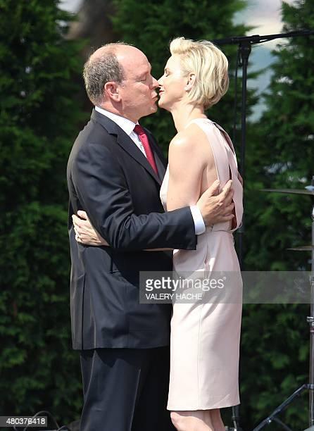 Princess Charlene of Monaco and Prince Albert II of Monaco embrace during celebrations marking Prince Albert II's decade on the throne on July 11...