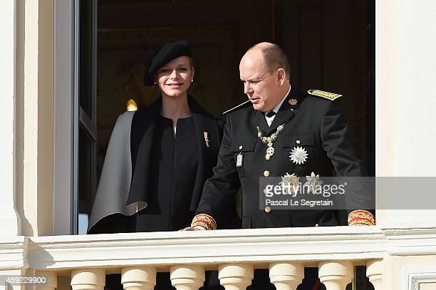 Princess Charlene of Monaco and Prince Albert II of Monaco greet the crowd from the palace's balcony during the National Day Parade as part of Monaco...