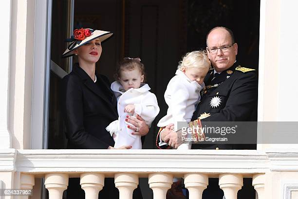 Princess Charlene of Monaco and Prince Albert II of Monaco greet the crowd from the palace's balcony with their children Princess Gabriella of Monaco...