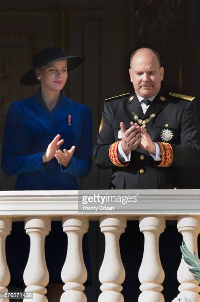 Princess Charlene of Monaco and Prince Albert II of Monaco greet the crowd from the palace's balcony during during the Monaco National Day...