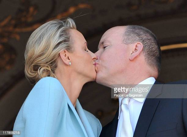 Princess Charlene of Monaco and Prince Albert II of Monaco kiss on the balcony after the civil ceremony of the Royal Wedding of Prince Albert II of...