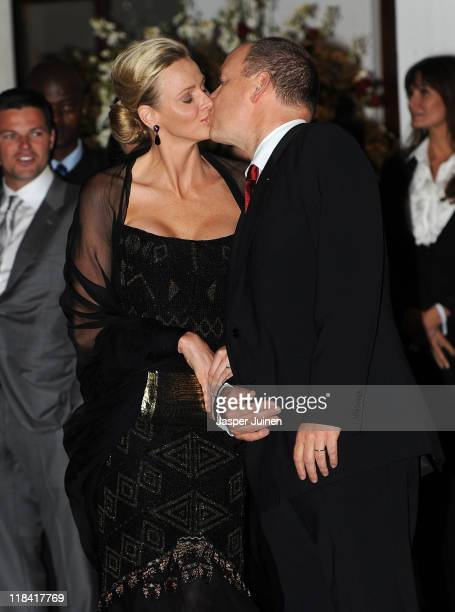 Princess Charlene of Monaco and Prince Albert II of Monaco kiss prior to a dinner party at Oyster Box on July 7 2011 in Durban South Africa