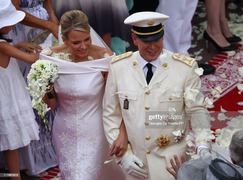Princess <a gi-track='captionPersonalityLinkClicked' href=/galleries/search?phrase=Charlene+-+Princess+of+Monaco&family=editorial&specificpeople=726115 ng-click='$event.stopPropagation()'>Charlene</a> of Monaco and <a gi-track='captionPersonalityLinkClicked' href=/galleries/search?phrase=Prince+Albert+II+of+Monaco&family=editorial&specificpeople=201707 ng-click='$event.stopPropagation()'>Prince Albert II of Monaco</a> leave the religious ceremony of the Royal Wedding of <a gi-track='captionPersonalityLinkClicked' href=/galleries/search?phrase=Prince+Albert+II+of+Monaco&family=editorial&specificpeople=201707 ng-click='$event.stopPropagation()'>Prince Albert II of Monaco</a> to Princess <a gi-track='captionPersonalityLinkClicked' href=/galleries/search?phrase=Charlene+-+Princess+of+Monaco&family=editorial&specificpeople=726115 ng-click='$event.stopPropagation()'>Charlene</a> of Monaco at the Prince's Palace on July 2, 2011 in Monaco. The Roman-Catholic ceremony follows the civil wedding which was held in the Throne Room of the Prince's Palace of Monaco on July 1. With her marriage to the head of state of Principality of Monaco, <a gi-track='captionPersonalityLinkClicked' href=/galleries/search?phrase=Charlene+-+Princess+of+Monaco&family=editorial&specificpeople=726115 ng-click='$event.stopPropagation()'>Charlene</a> Wittstock has become Princess consort of Monaco and gain the title, Princess <a gi-track='captionPersonalityLinkClicked' href=/galleries/search?phrase=Charlene+-+Princess+of+Monaco&family=editorial&specificpeople=726115 ng-click='$event.stopPropagation()'>Charlene</a> of Monaco. Celebrations including concerts and firework displays are being held across several days, attended by a guest list of global celebrities and heads of state.
