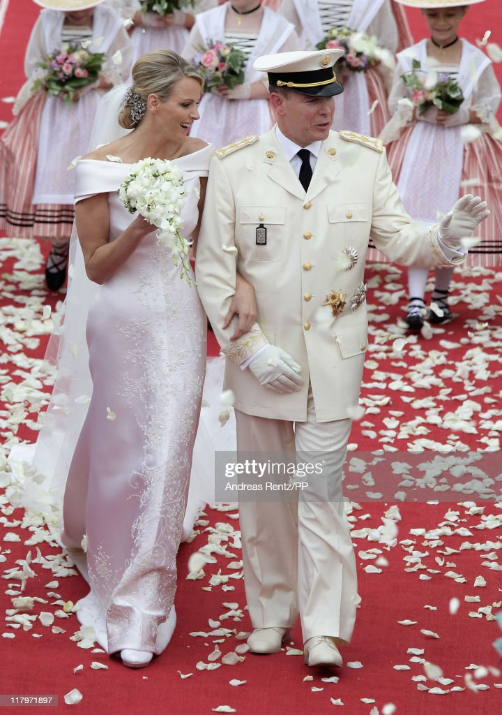 Princess <a gi-track='captionPersonalityLinkClicked' href=/galleries/search?phrase=Charlene+-+Princess+of+Monaco&family=editorial&specificpeople=726115 ng-click='$event.stopPropagation()'>Charlene</a> of Monaco and <a gi-track='captionPersonalityLinkClicked' href=/galleries/search?phrase=Prince+Albert+II+of+Monaco&family=editorial&specificpeople=201707 ng-click='$event.stopPropagation()'>Prince Albert II of Monaco</a> leave the religious ceremony of the Royal Wedding of <a gi-track='captionPersonalityLinkClicked' href=/galleries/search?phrase=Prince+Albert+II+of+Monaco&family=editorial&specificpeople=201707 ng-click='$event.stopPropagation()'>Prince Albert II of Monaco</a> to Princess <a gi-track='captionPersonalityLinkClicked' href=/galleries/search?phrase=Charlene+-+Princess+of+Monaco&family=editorial&specificpeople=726115 ng-click='$event.stopPropagation()'>Charlene</a> of Monaco in the main courtyard at the Prince's Palace on July 2, 2011 in Monaco. The Roman-Catholic ceremony follows the civil wedding which was held in the Throne Room of the Prince's Palace of Monaco on July 1. With her marriage to the head of state of the Principality of Monaco, <a gi-track='captionPersonalityLinkClicked' href=/galleries/search?phrase=Charlene+-+Princess+of+Monaco&family=editorial&specificpeople=726115 ng-click='$event.stopPropagation()'>Charlene</a> Wittstock has become Princess consort of Monaco and gains the title, Princess <a gi-track='captionPersonalityLinkClicked' href=/galleries/search?phrase=Charlene+-+Princess+of+Monaco&family=editorial&specificpeople=726115 ng-click='$event.stopPropagation()'>Charlene</a> of Monaco. Celebrations including concerts and firework displays are being held across several days, attended by a guest list of global celebrities and heads of state.