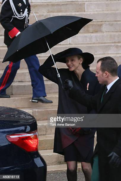 Princess Charlene of Monaco and Prince Albert II of Monaco leave the Cathedral of Monaco after a mass during the official ceremonies for the Monaco...
