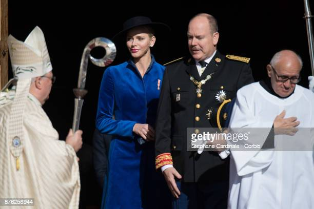 Princess Charlene of Monaco and Prince Albert II of Monaco leave the Cathedral of Monaco after a mass during the Monaco National Day Celebrations on...