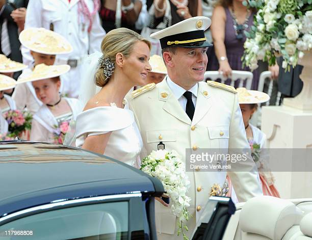 Princess Charlene of Monaco and Prince Albert II of Monaco make their journey to Sainte Devote church after their religious wedding ceremony at the...