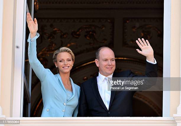Princess Charlene of Monaco and Prince Albert II of Monaco pose on the balcony after the civil ceremony of the Royal Wedding of Prince Albert II of...