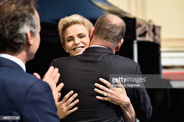 Princess Charlene of Monaco and Prince Albert II of Monaco pose onstage during the First Day of the 10th Anniversary on the Throne Celebrations on...