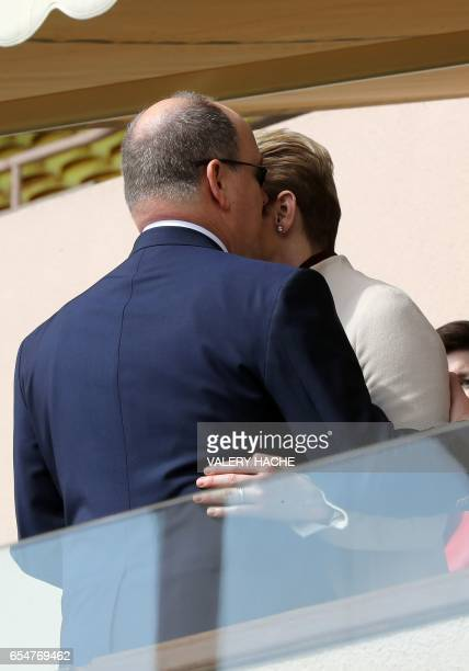 Princess Charlene of Monaco and Prince Albert II of Monaco stand together as they attend the International Rugby tournament Tournoi Sainte Devote at...