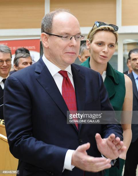 Princess Charlene of Monaco and Prince Albert II of Monaco visit Aurillac central France on May 14 during a state visit to the French central Cantal...