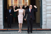 Princess Charlene of Monaco and Prince Albert II of Monaco walk on the Palace Place during the First Day of the 10th Anniversary on the Throne...
