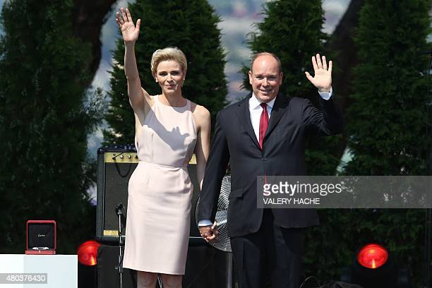 Princess Charlene of Monaco and Prince Albert II of Monaco wave during celebrations marking Prince Albert II's decade on the throne on July 11 2015...
