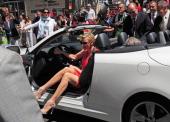 Princess Charlene of Monaco and Prince Albert of Monaco alight from a car before the Monaco Formula One Grand Prix at the Circuit de Monaco in Monte...
